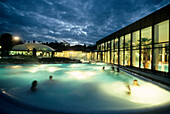 People in the outdoor pool at Alpamare Baths in the evening, Bad Toelz, Bavaria, Germany