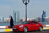 Skyline of Abu Dhabi with luxury car, United Arab Emirates, UAE