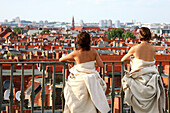 Art performance over city roofs, Berlin, Germany