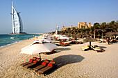 Sun Loungers at Jumeirah Beach, View at Burj al Arab Hotel, Jumeirah District, Dubai, United Arab Emirates, UAE