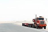 Truck takes a break in the desert, Dubai, United Arab Emirates, UAE