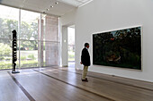 Person looking at a painting, artwork in Fondation Beyeler, Basel, Switzerland