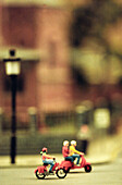 Cities, City, Color, Colour, Contemporary, Figure, Figures, Indoor, Indoors, Inside, Interior, Miniature, Miniatures, Model, Models, Moped, Mopeds, Ride, Riding, Selective focus, Street, Street scene, Street scenes, Streets, Traffic, Transport, Transport