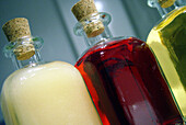 Bottle, Bottles, Close up, Close-up, Closeup, Color, Colour, Concept, Concepts, Detail, Details, Different, Horizontal, Indoor, Indoors, Inside, Interior, Lined up, Lined-up, Liquid, Liquids, Object, Objects, Still life, Thing, Things, Three, Three items
