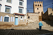 Woman walking on typical street. Chefchaouen. Morocco