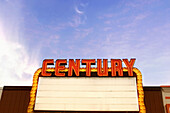 Attracting attention, Blue, Blue sky, Century, Cinema, Cinemas, Color, Colour, Concept, Concepts, Daytime, Exterior, Horizontal, Lit, Movie theatre, Neon, Outdoor, Outdoors, Outside, Sign, Signs, Skies, Sky, Theater, Theaters, Theatre, Theatres, L05-3385