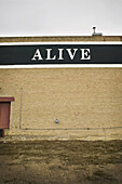 The word alive is written on a building in Saskatchewan, Canada.
