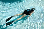 A diver taking a diving lesson in resort s pool, Varadero, Cuba.