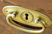 Aged, Close up, Close-up, Closeup, Color, Colour, Concept, Concepts, Detail, Details, Drawer, Drawers, Furniture, Golden, Handle, Handles, Horizontal, Indoor, Indoors, Inside, Interior, Keyhole, Keyholes, Lock, Locked, Locks, Metal, Old, One, Security, L