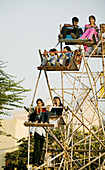 Indian kids and teenagers on ferris wheel on Chowpatty Beach. Mumbai (ex Bombay). India