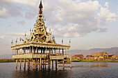 Burma (Union of Myanmar), Inle Lake, Lake dwelling village. Pagoda built ont stilts.