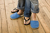 Adult, Adults, Anonymous, At home, Blue jean, Blue jeans, Color, Colour, Comfort, Comfortable, Concept, Concepts, Couple, Couples, Denim, Feet, Female, Foot, Footgear, Footwear, Home, Human, Indoor, Indoors, Interior, Jean, Jeans, Lifestyle, Lifestyles,