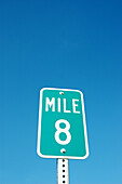 8 eight mile distance marker sign on freeway highway