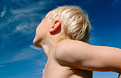 Anonymous, Blond, Blonds, Blue sky, Boy, Boys, Caucasian, Caucasians, Child, Children, Color, Colour, Contemporary, Daytime, Exterior, Fair-haired, Half-naked, Horizontal, Kid, Kids, Low angle view, Male, Outdoor, Outdoors, Outside, Posture, Postures, Pr