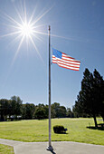 4th of July, America, American flag, Americana, Blue, Blue sky, Color, Colour, Concept, Concepts, Countries, Country, Daytime, Exterior, Flag, Flag at half-mast, Flag at half-staff, Flagpole, Flagpoles, Flags, Flags at half-staff, Fourth of July, Grass,