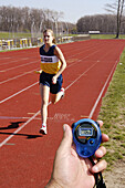 Hand held digital stop watch which is used to time runners during a track and field event