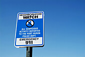 Neighborhood watch sign advises suspicious activity to be reported to 911 police