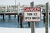 Sign indicating danger thin ice and open water