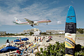 Air planes land at runway which ends at the Sun Beach on the caribbean Island of St. Maarten Martin in the West Indies