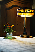 Lamp and flowers, Romania