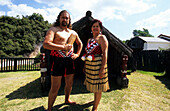 Traditionally dressed Maori couple in a Maori Village on the North Island, New Zealand
