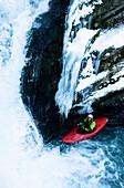 Man kayaking at Strumboding Water Fall in winter, Upper Austria, Austria