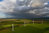 aerial view of wind turbines in the landscape, autobahn, dark clouds, near Hanover, Lower Saxony, northern Germany