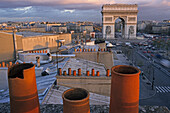 View over roofs onto Arch of Triumph in the evening, Place de l'Etoile, Paris, France, Europe