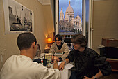 Students in an attic flat, apartment with view of the Sacre Coeur, Paris, France