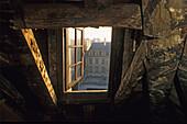 Attic window under the roof, Places Vosges, Paris, France