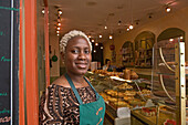 African saleswoman with bleached hair, bakery, Paris, France