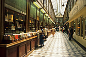 People in front of a second hand bookshop at Passage Jouffroy, 9. Arrondissement, Paris, France, Europe
