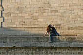 Young couple kissing on the quay wall of the Seine, Paris, France, Europe