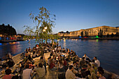 People relaxing on the tip of the Isle de la Cité in the evening, Paris, France, Europe