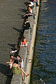 Couples meeting on the quay of the Seine river, Paris, France, Europe