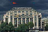 Exterior view of La Samaritaine department store under clouded sky, 1e Arrondissement, Paris, France, Europe