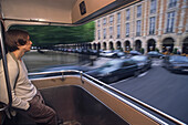 Passenger on open platform of public bus, Place des Vosges, Paris, France, Europe