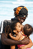 Jamaica Boston bay Jamaican father with kids kissing each other