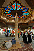 Oman Muscat Mutrah Souk, arab people, colorful ceiling with colorful glas