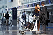 Business people travelling at Frankfurt Airport, Frankfurt, Germany