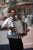 Street Musician playing the accordion, Port de Soller, Mallorca, Balearic Islands, Spain