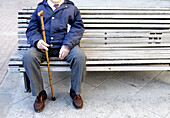 Adult, Adults, Alone, Anonymous, Bench, Benches, Cane, Canes, Color, Colour, Contemporary, Daytime, Exterior, Full-body, Full-length, Horizontal, Human, Leisure, Loneliness, Male, Man, Mature Adult, Mature Adults, Mature people, Men, Men only, Oap, One, O
