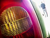 Adult, Adults, Auto, Automobile, Automobiles, Autos, Back view, Car, Cars, Close up, Close-up, Closeup, Color, Colour, Daytime, Detail, Details, Exterior, Full-body, Full-length, Headlight, Headlights, Horizontal, Human, Lights, Lit, Male, Man, Men, Men o