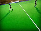 Adult, Adults, Artificial grass, Color, Colour, Contemporary, Distance, Exterior, Field, Field hockey, Fields, Game, Games, Green, Half, Halves, Hockey, Horizontal, Human, Leisure, Line, Lines, Match, Matches, Opponent, Opponents, Outdoor, Outdoors, Outsi