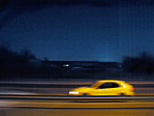 Auto, Automobile, Automobiles, Autos, Blurred, Car, Cars, Color, Colour, Contemporary, Exterior, Fast, Highway, Highways, Horizontal, Night, Nighttime, One, Outdoor, Outdoors, Outside, Road, Roads, Single, Special effects, Speed, Thoroughfare, Thoroughfar