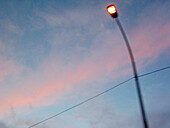 Cloud, Clouds, Color, Colour, Concept, Concepts, Detail, Details, Dusk, Electricity, Energy, Ephemeral, Exterior, Horizontal, Lit, Low angle view, One, Outdoor, Outdoors, Outside, Pink, Power, Skies, Sky, Street lamp, Street lamps, Twilight, Urban, View f
