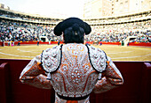 Adult, Adults, Back view, Bull-ring, Bull-rings, Bullfight, Bullfighter, Bullfighter costume, Bullfighter costumes, Bullfighters, Bullfighting, Bullfights, Bullring, Bullrings, Color, Colour, Contemporary, Daytime, Exterior, Folk, Folklore, Human, Male, M