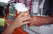 Adult, Adults, Anonymous, Boy, Boys, Buy, Buying, Child, Children, Color, Colour, Contemporary, Daytime, Detail, Details, Exterior, Food, Hand, Hands, Hold, Holding, Human, Ice cream, Ice creams, Ice-cream, Ice-creams, Kid, Kids, Male, Man, Men, Nourishme