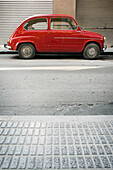 600, Auto, Automobile, Automobiles, Autos, Car, Cars, Color, Colour, Daytime, Exterior, Old fashioned, Old-fashioned, Outdoor, Outdoors, Outside, Parked, Pavement, Pavements, Red, Seat, Seat 600, Sidewalk, Sidewalks, Street, Streets, Transport, Transporta