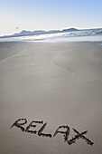 Relax message in the sand, Famara beach. Lanzarote, Canary Islands, Spain